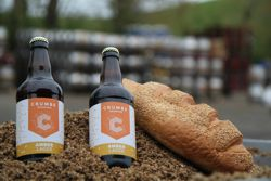 Crumbs Brewing beer bottles and bread Reigate