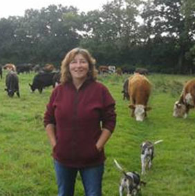 Penny Vaughan from Brightleigh Farm, Outwood, in a field of beef cattle