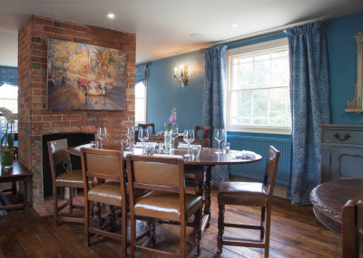 The elegant dining room at The Wheatsheaf at Bough Beech