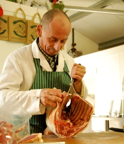 Butcher preparing a joint of meat for delivery by Fin and Farm, Hove | Local Food Sussex
