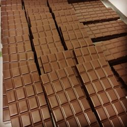 Unwrapped artisan chocolate bars made by Rowdy and Fancy's of Forest Row, Sussex