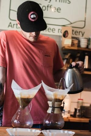 Pouring a fresh brew at the Guildford coffee shop