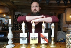 Titsey Brew Co founder Craig Vroom with his beers