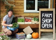 Noel Dobson outside his farm shop at Working
