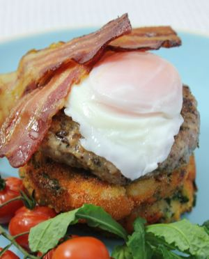 Gluten-free kale potato cakes with sausage, bacon and poached egg